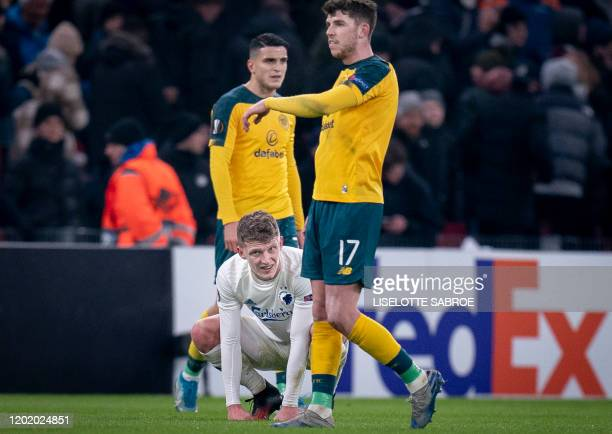 Copenhagen's Jens Stage and Celtic's Ryan Christie react at the end of the Europa League last 32 first leg football match between FC Copenhagen and...