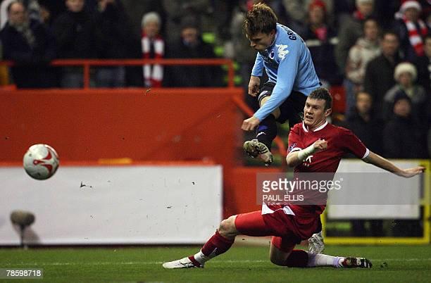 FC Copenhagen's Jesper Gronkjaer shoots past Aberdeen's Andrew Considine during their UEFA Cup Group B Qualifying match at Pittodrie Stadium Aberdeen...