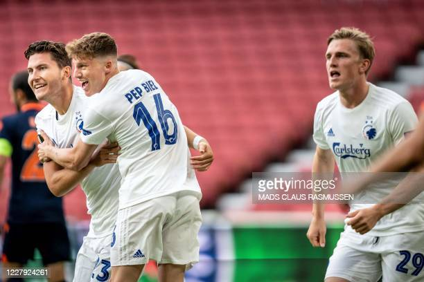 Copenhagen's Jonas Wind celebrates with teammate FC Copenhagen's Pep Biel after scoring during the UEFA Europa League round of 16 football match...