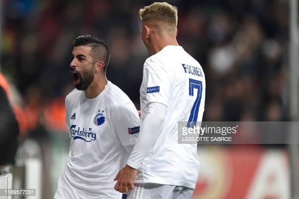 Copenhagen's Michael Santos celebrates scoring a goal with teammate Viktor Fischer during the UEFA Europa League Group B football match FC Copenhagen...