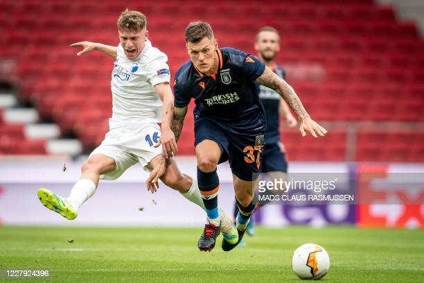 Copenhagen's Pep Biel and Istanbul Basaksehir's Martin Skrtel vie for the ball during the UEFA Europa League round of 16 football match between FC...