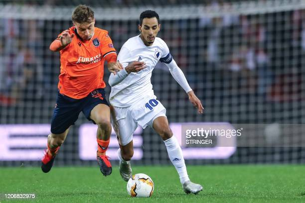 Copenhagen's Portuguese midfielder Zeca vies for the ball with Basaksehir's Moldovan defender Alexandru Epureanu during the UEFA Europa league last...