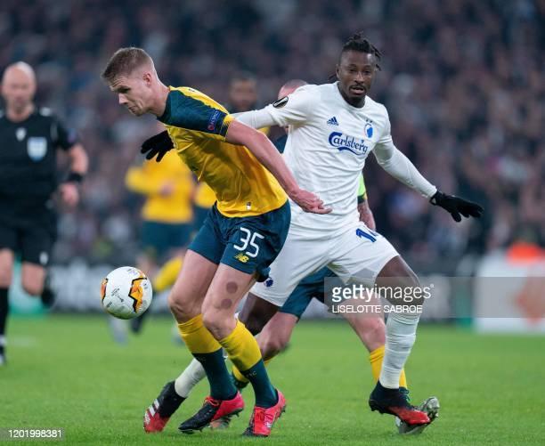 FC Copenhagen's Senegalese forward Dame N'Doye and Celtic's Norwegian defender Kristoffer Ajer vie for the ball during the Europa League last 32...