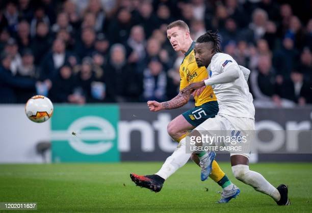 FC Copenhagen's Senegalese forward Dame N'Doye gets past Celtic's Irish midfielder Jonny Hayes to score the 11 goalduring the Europa League last 32...