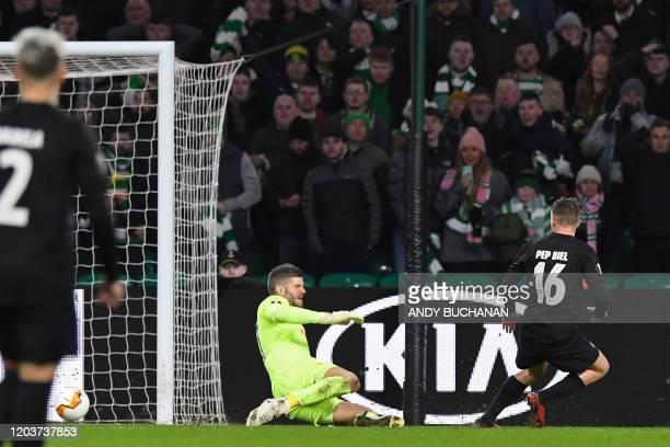 FC Copenhagen's Spanish midfielder Pep Biel scores their second goal past Celtic's English goalkeeper Fraser Forster during the UEFA Europa League...