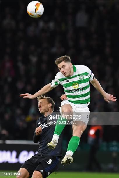 FC Copenhagen's Swedish defender Pierre Bengtsson vies with Celtic's Scottish midfielder James Forrest during the UEFA Europa League round of 32...
