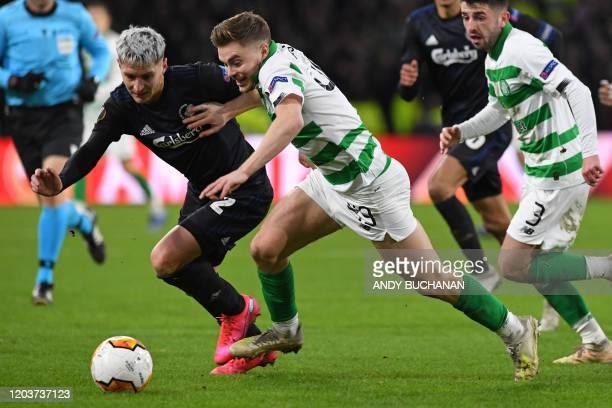 FC Copenhagen's Uruguayan defender Guillermo Varela vies with Celtic's Scottish midfielder James Forrest during the UEFA Europa League round of 32...