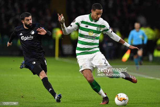 FC Copenhagen's Uruguayan striker Michael Santos vies with Celtic's French defender Christopher Jullien during the UEFA Europa League round of 32...
