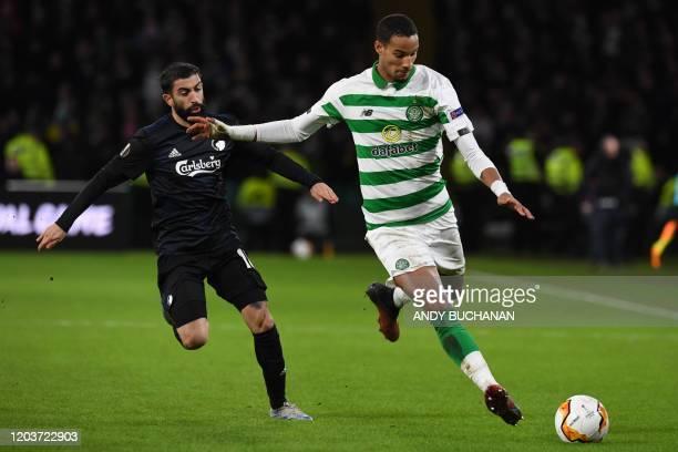 FC Copenhagen's Uruguayan striker Michael Santos vies with Celtic's French defender Christopher Jullien during the UEFA Europa League round of 32...