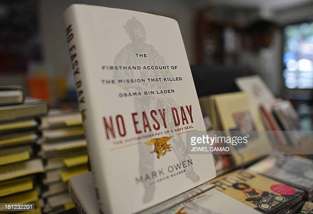 Copies of a book by former Navy SEAL tittled No Easy Day are seen on display at a bookstore in Washington DC on September 4 2012 The Pentagon said...