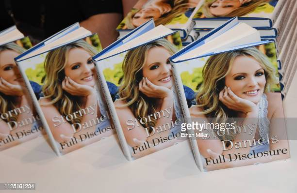 Copies of adult film actress/director Stormy Daniels' book 'Full Disclosure' are displayed during a signing at the 2019 AVN Adult Entertainment Expo...