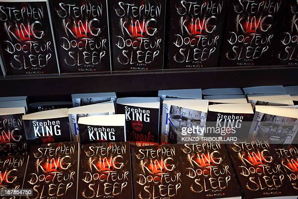 Copies of American author Stephen King's new book Doctor Sleep the sequel to his 1977 novel The Shining are displayed on November 13 2013 in Paris...