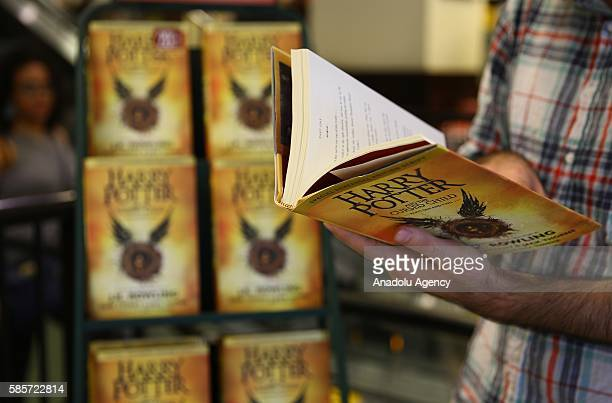 Copies of British author JK Rowlings latest book Harry Potter and the Cursed Child on display at a bookstore in New York United States on August 3...