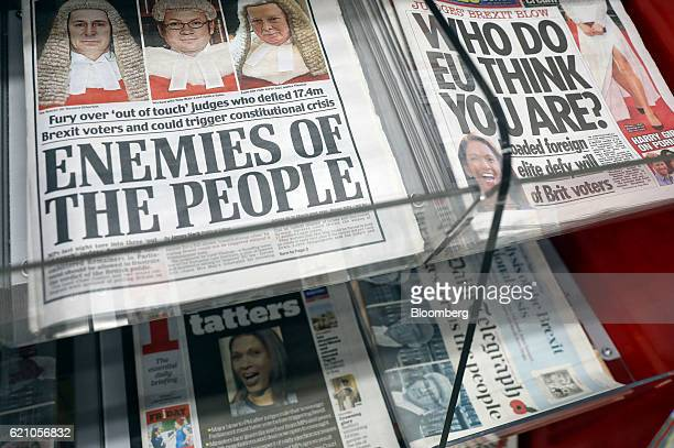 Copies of British national newspapers tabloids and broadsheet carry the story of the High Court battle over Article 50 on their front pages as they...