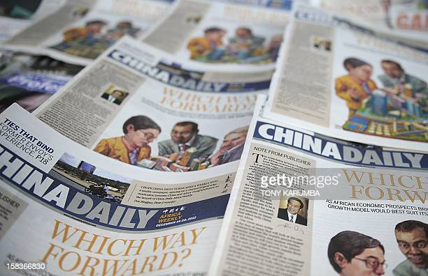 Copies of China's Africa edition of its daily newspaper sits on a news stand in the Kenyan capital Nairobi on December 14, 2012. China today launched...