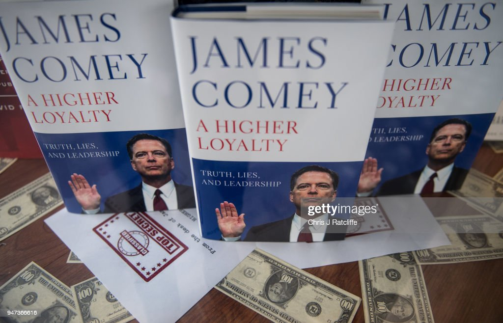 Copies of Former FBI Director James Comey's book are seen on display in a window at Waterstone's, Piccadilly on April 17, 2018 in London, England. The former Federal Bureau of Investigations Director was fired by US President Donald Trump in 2017 and has since written his book 'A Higher Loyalty' about everything from his childhood to his time as FBI Director and his firing by the president.