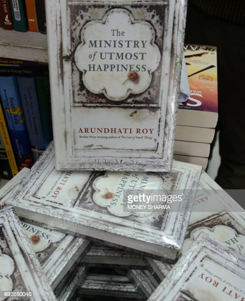 Copies of Indian writer Arundhati Roy's novel 'The Ministry of Utmost Happiness' are stacked up at a book store in New Delhi on June 6 2017 Arundhati...