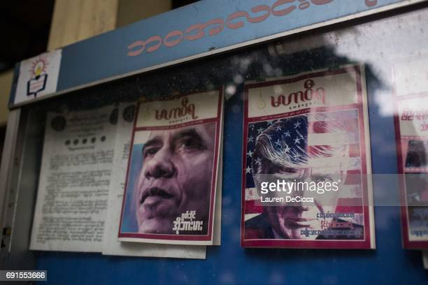 Copies of Mahar Wira Magazine featuring Barack Obama and Donald Trump hang at the entrance to the Masaeyein Monastery on May 31 2017 in Mandalay...