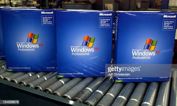 Copies of Microsoft's new operating system Windows XP Pro roll off the packaging line in Greeley Colorado October 10 2001 as the company makes last...