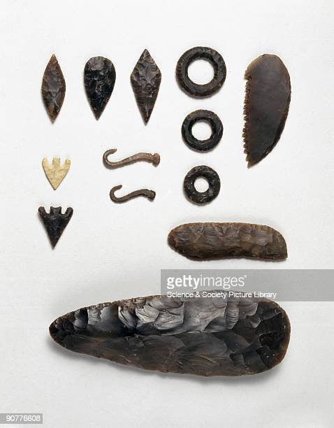 Copies of Neolithic implements two fish hooks three rings one cross one heart one chipped axe three barbed arrows three leaf arrows one flint knife...