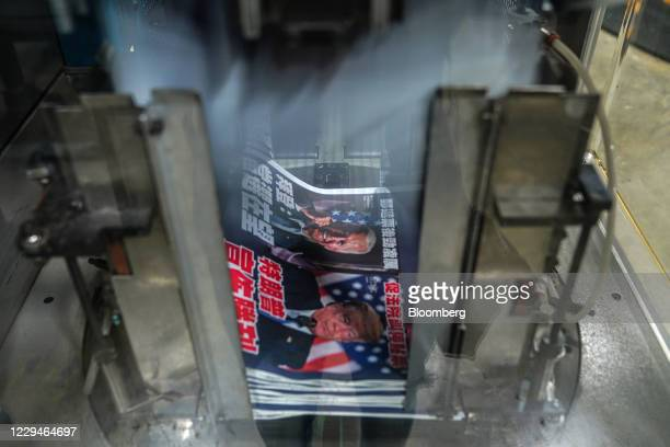 Copies of Next Digital Ltd.'s Apple Daily newspaper with a front page story on the U.S. Presidential election at the company's printing facility in...