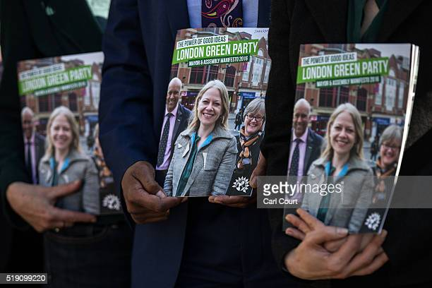 Copies of Sian Berry's manifesto are held by Green Party members after Green Party candidate for London mayor Sian Berry launched her manifesto at a...