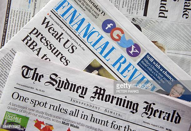 Copies of the Australian Financial Review and the The Sydney Morning Herald are seen for sale on a news stand in Sydney on August 1 2016 Leading...