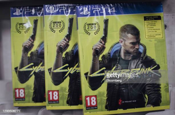 Copies of the Cyberpunk 2077 computer game, produced by CD Projekt SA, for the PlayStation 4 console in a video games store in Paris, France, on...
