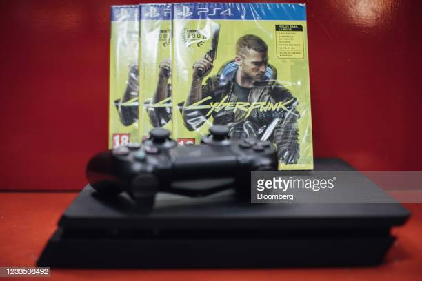 Copies of the Cyberpunk 2077 computer game, produced by CD Projekt SA, beside a PlayStation 4 console in a video games store in Paris, France, on...