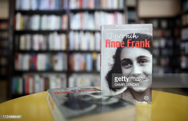 Copies of 'The Diary of Anne Frank' are seen on a table in a public library in Zagreb on February 14 2019 A decision to drop Jewish Anne Frank's...