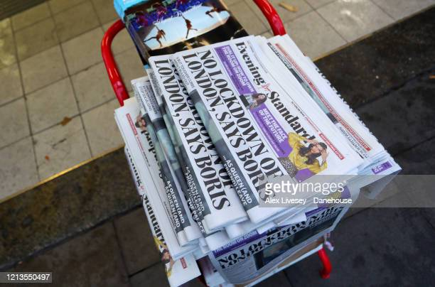 Copies of The Evening Standard with the headline No Lockdown of London, says Boris as the UK adjusts to life under the Coronavirus pandemic on March...