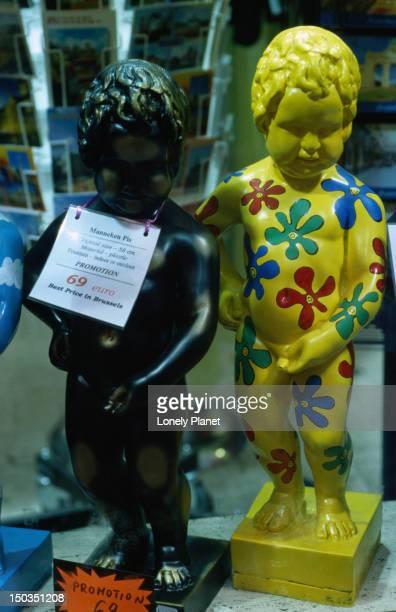 Copies of the famous Manneken Pis statue for sale.