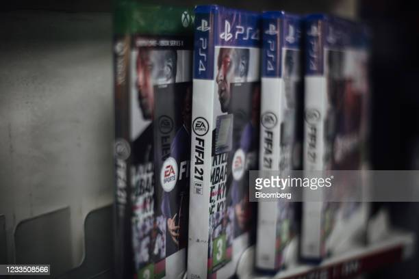 Copies of the FIFA 2021 soccer game, produced by Electronic Artists Inc., for the PlayStation 4 console at a video games store in Paris, France, on...