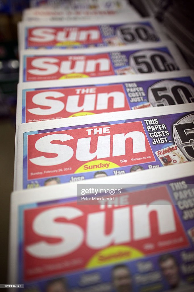 Copies of the first ever edition of The Sun on Sunday newspaper are displayed for sale in a convenience store on February 26, 2012 in Leatherhead, England. Rupert Murdoch's News International closed the News of The World Sunday tabloid newspaper in 2011 after revelations of phone hacking and it's new Sunday newspaper was launched today with an initial print run of three million copies.