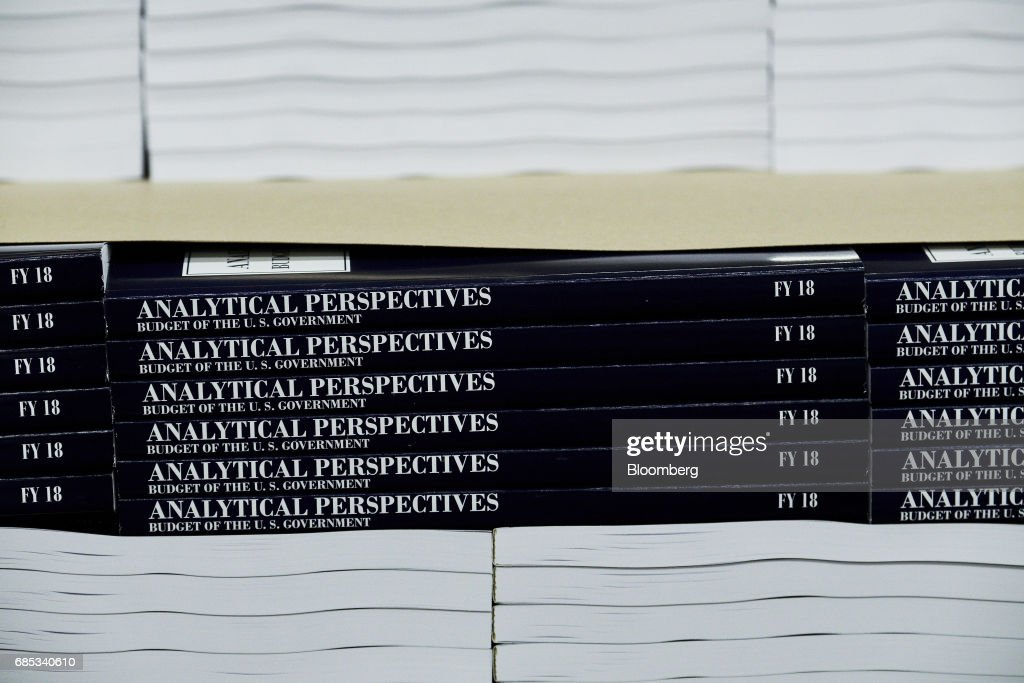 Copies of the fiscal year 2018 budget sit stacked inside the Government Publishing Office (GPO) production facility in Washington, D.C., U.S., on Friday, May 19, 2017. PresidentDonald Trumpwill send to Congress on Tuesday a proposal for balancing the federal budget within 10 years through deep cuts to discretionary and safety net spending, according to a U.S. official. Photographer: T.J. Kirkpatrick/Bloomberg via Getty Images