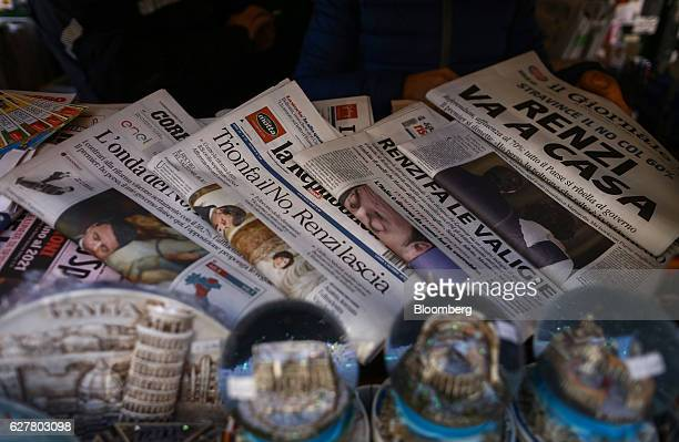 Copies of the Italian daily newspapers, including La Repubblica, center, and Il Giornale, right, sit on a newspaper stand after the Italian vote on...