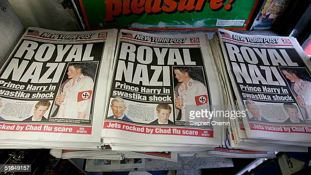 Copies of the New York Post lie on display at a newstand featuring a Royal Nazi front page headline January 13 2005 in New York City British royal...