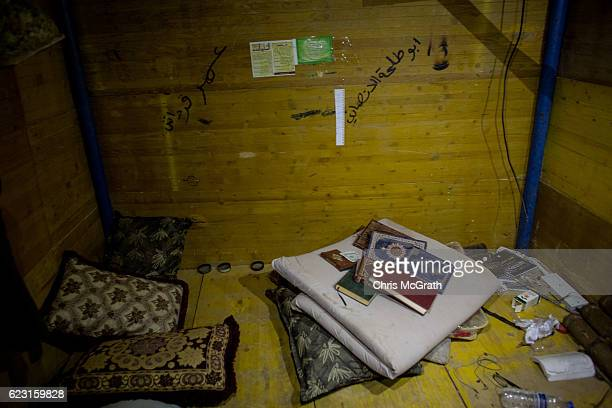 Copies of the Quran are seen in a bedroom inside a tunnel used by ISIS on November 14, 2016 in Ba'ashiqah, Iraq. The mosul offensive has slowed due...