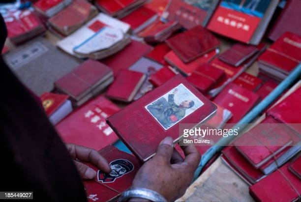 Copies of the red book of chairman Mao TseTung for sale in the local market in the ancient city of Dali in Yunnan Southwest China Dali is a popular...