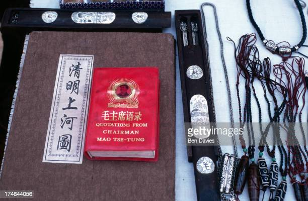 Copies of the red book of chairman Mao TseTung for sale in the market in Dali in Yunnan Province Southern China