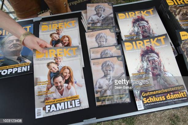 Copies of the rightwing magazine Info Direkt lie on display at a gathering entitled Europa Nostra and hosted by the Identitarian Movement on August...