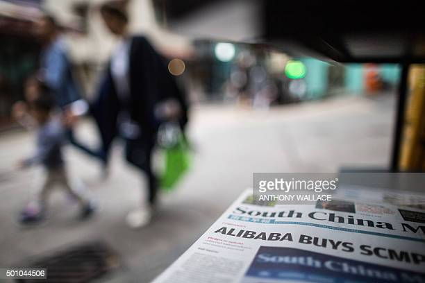 Copies of the South China Morning Post are displayed at a newsstand in Hong Kong on December 12 following its acquisition by Chinese internet giant...