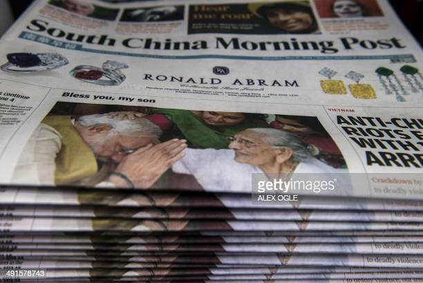 Copies of the South China Morning Post newspaper are stacked for sale at a shop in Hong Kong with a front cover leading with the victory of India's...