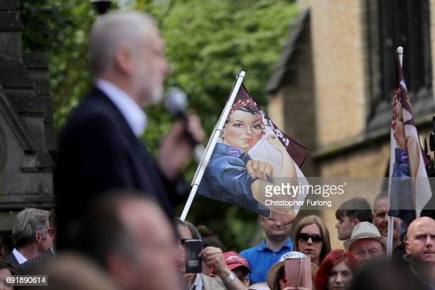 Copies of the 'We Can Do It' poster adorn some flags held up by supporters as Labour leader Jeremy Corbyn addresses a rally of supporters at Hucknall...