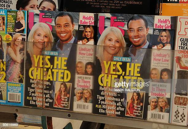 Copies of Us Weekly magazine featuring the story on Tiger Woods and the interview with alleged mistress Jaimee Grubbs are seen for sale on the...