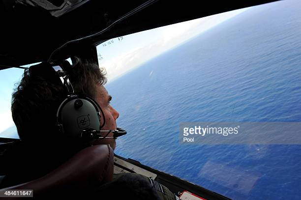 Copilot and Squadron Leader Brett McKenzie of the Royal New Zealand Airforce P3K2Orion aircraft helps to look for objects during the search for...