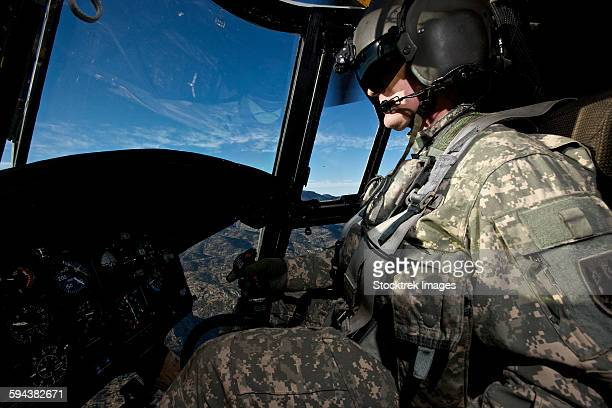 Co-pilot flying a CH-47 Chinook helicopter.