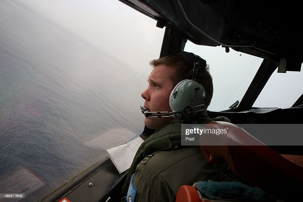 Co-Pilot, Flying Officer Marc Smith looks out as he turns his RAAF AP-3C Orion aircraft at low level in bad weather while searching for missing Malaysia Airways Flight MH370 on March 24, 2014 off the South West Coast of Perth, Australia. Malaysian Prime Minister Najib Razak spoke at a press conference today to announce that fresh analysis of available satellite data has concluded that missing flight MH370's final position was in the southern Indian Ocean. French authorities reported a satellite sighting of objects in an area of the southern Indian Ocean where China and Australia have also reported similar sightings of potential debris from the flight that went missing on March 8.