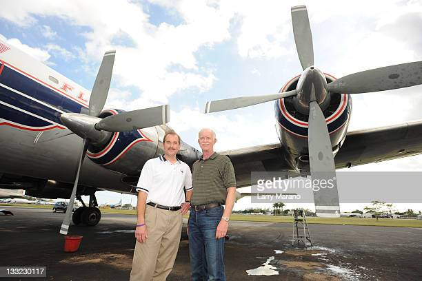Copilot Jeff Skiles and Captain Sully Sullenberger pose with the Historical 1958 DC7 to benefit hosted by Historical Flight Foundation on November 17...