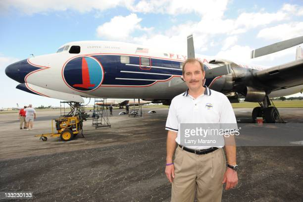 Copilot Jeff Skiles poses with the Historical 1958 DC7 to benefit hosted by Historical Flight Foundation on November 17 2011 in Miami Florida